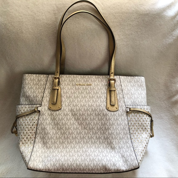 cae8236a4c92 MK Voyager East West Signature Tote Vanilla Gold.  M_5b888c299264af63267e5067. Other Bags you may like. Michael Kors Handbag